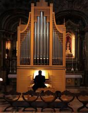 Man Playing Pipe Organ In A Church