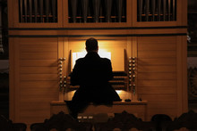 Man Playing Pipe Organ In A Church