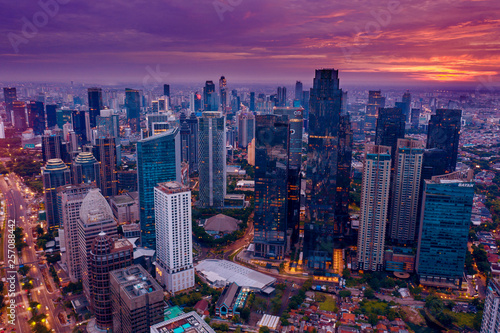 Photo sur Toile Prune Jakarta city with skyscrapers at twilight time