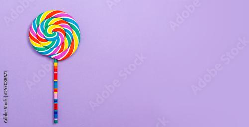 Fotografie, Obraz Big lollipop on a purple paper background