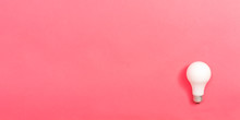 Colored Light Bulb On A Pink P...