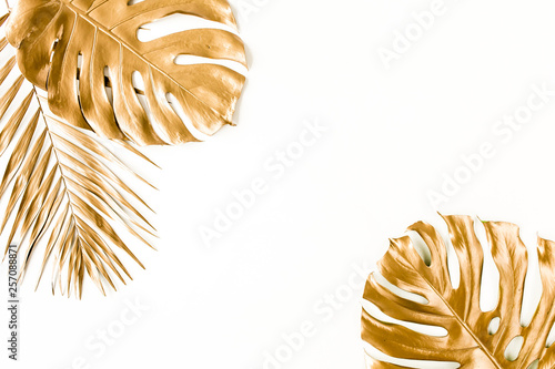 Poster Floral Gold tropical palm leaves on white background. Flat lay, top view minimal concept.