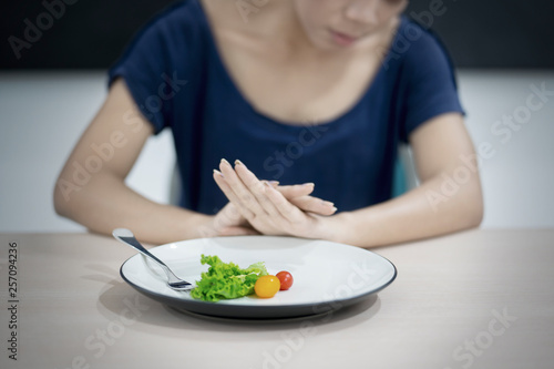 Fotografia, Obraz  Young woman refusing fresh salad
