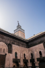 Details Of The Famous Medersa Attarine And A Beautiful Minaret In The Middle Of Fes, Morocco.