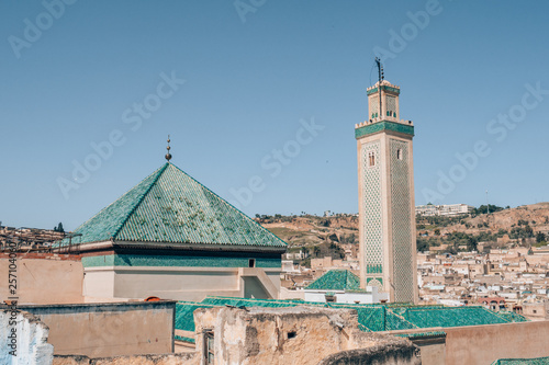 A beautiful panorama view of a minaret and roofs of the northern city Fes, Morocco.