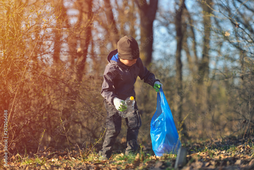 Fototapeta Recycle waste litter rubbish garbage trash junk clean training. Nature cleaning, volunteer ecology green concept. Young men and boys pick up spring forest at sunset. Environment plastic pollution