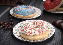 Colorful Glazed Donuts On Blac...