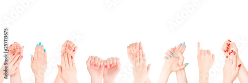 Valokuva Hands with colored nail polish set in the row isolated with clipping path