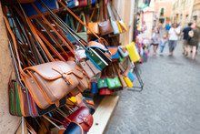 Rome, Italy Many Leather Purse Bags Vibrant Colors Hanging On Display In Shopping Street Market In Roma City