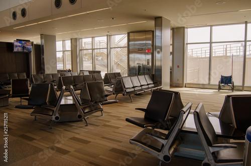Obraz na plátně  Inside Airport with empty gate and seats