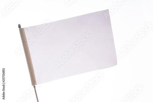 Photo White flag on a white background in display