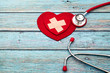 canvas print picture - World health day, healthcare and medical concept, red stethoscope and red heart on the blue wooden background