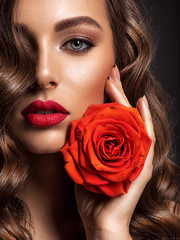 Fototapeta na wymiar Beautiful woman with brown hair. Beautiful face of an attractive model with fashion makeup.