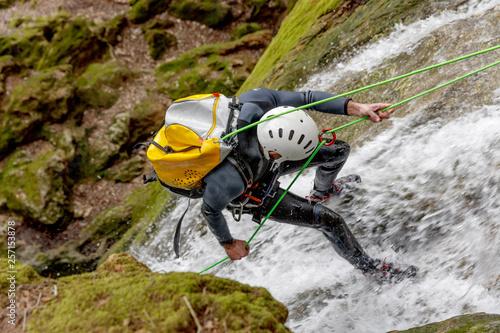 Fototapeta man practicing canyoning