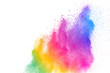 Freeze motion of colored powder explosions isolated on white background.Color dust particle splattered on background