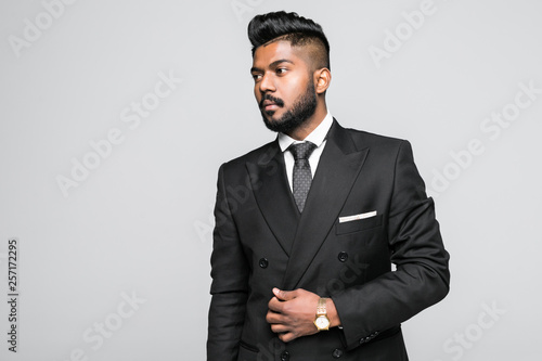 Fotografie, Obraz  Portrait of a confident, smiling indian businessman with arms crossed, isolated