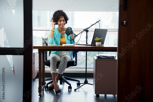 Fényképezés  Attractive African American Young Woman Doing Online Podcast With Microphone