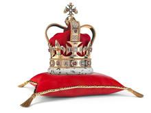 Golden Crown On Red Velvet Pillow For Coronation. Royal Symbol Of British UK Monarchy.