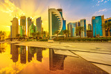 Beautiful cityscape of Doha West Bay skyline at sunset sky reflections in Downtown Park. Modern glassed towers of Doha in Qatar, Middle East, Arabian Peninsula in Persian Gulf.