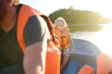Mature Father And Little Son Boating On A River Or Pond At Sunny Summer Day. Quality Family Time Together On Nature.