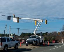 Power Company Worker Repairing Traffic Light