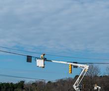 Power Company Worker Repairing...
