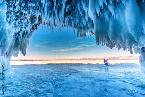Fototapeta Inside the blue ice cave with couple love at Lake Baikal, Siberia, Eastern Russia