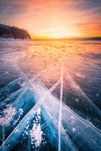In de dag Nachtblauw Sunset sky with natural breaking ice over frozen water on Lake Baikal, Siberia, Russia.