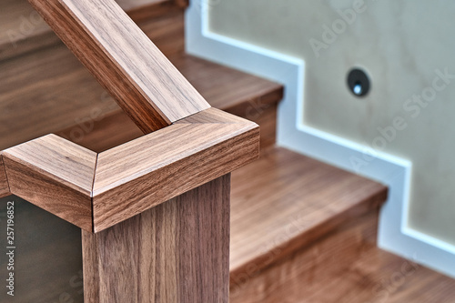 Valokuva  Part of wooden steps with glass railings. Walnut staircase