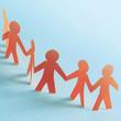 Leinwanddruck Bild - Team of paper doll people holding hands