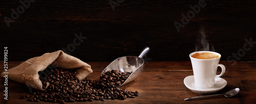 Fototapeta cup of coffee and coffee beans obraz