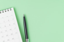 White Clean Calendar With Black Pen On Pastel Green Background With Copy Space Using As Reminder, Schedule, Meeting Agenda And Work Planning Concept