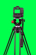 canvas print picture - Dslr camera with green screen on the tripod isolated on green background. The chromakey. Green screen.