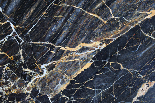 Fotografering Gold and cream color patterned natural of dark blue gray marble pattern background, abstract marble texture