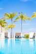 canvas print picture Luxury White beach bed chairs, cabanas, lounge Sundeck by swimming pool side, vertical composition