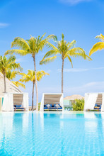 Luxury White Beach Bed Chairs, Cabanas, Lounge Sundeck By Swimming Pool Side, Vertical Composition