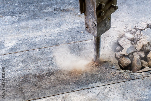 Fotografia, Obraz excavator jack hammer in action and textspace