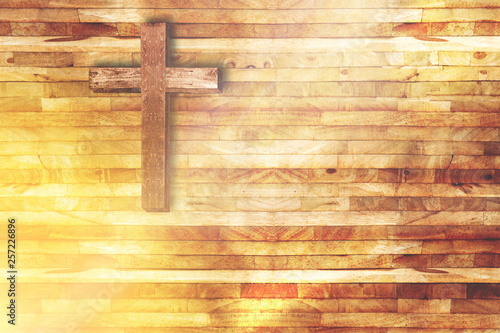 Obraz na plátně  wood cross on wooden background in church with ray of light from below