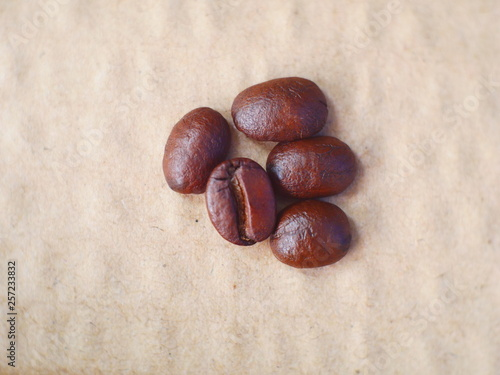 organic coffee beans on brown paper background