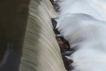 Motion Blurred Waterfall Splashes Off Rocks In North Georgia River