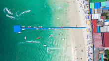 Aerial Top View Of Beautiful Tropical Beach With White Sand And Turquoise Clear Water, Boat Anchored In Tawaen Beach Ko Lan Chon Buri Thailand, Luxury Yacht