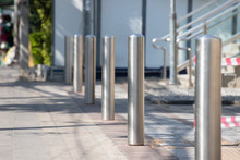 Stainless Steel Bollards On Footpath.