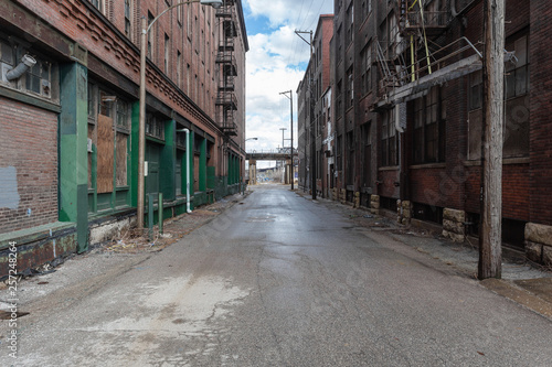 Looking down a vintage industrial street scene with classic red brick factories