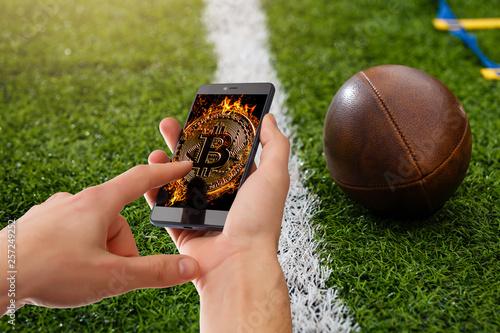 Obraz na płótnie Golden bitcoin coin dollar against digital currency sports, football, ball backg