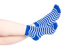 Female Legs With Blue Socks Fashion On Background Isolation
