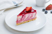 Strawberry Cheesecake On A White Plate