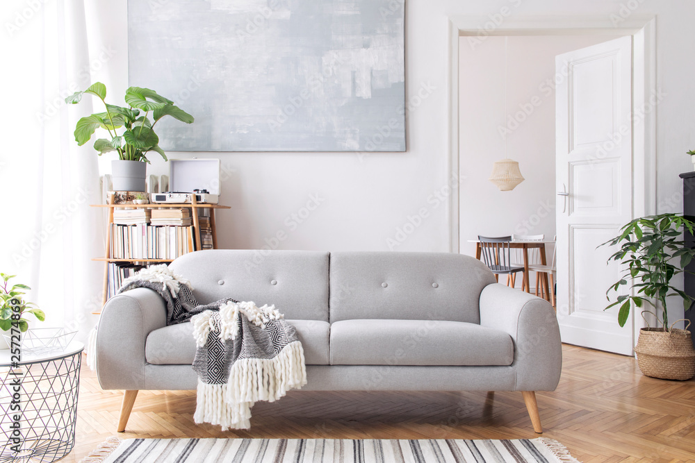 Fototapety, obrazy: Stylish scandianvian living room with design sofa with elegant blanket, coffee table and bookstand on the white wall. Brown wooden parquet. Concept of minimalistic decor interior with piano. Mock up.