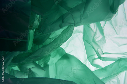 Plastic bag background. Green background. Texture with copy space for text. Plastic concept.