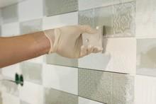 Closeup Of Tiler Hand Rubbing ...