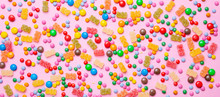 Birthday Concept. Colorful Sweet Candies On Pink Background